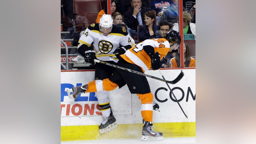 Philadelphia Flyers' Sean Couturier, right, and Boston Bruins' Dennis Seidenberg, of Germany, collide during the second period of an NHL hockey game, Tuesday, April 23, 2013, in Philadelphia. (AP Photo/Matt Slocum)