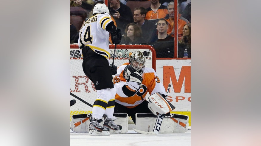Philadelphia Flyers goalie Steve Mason, right, blocks a shot as Boston Bruins' Dennis Seidenberg, of Germany, looks for the rebound during the second period of an NHL hockey game, Tuesday, April 23, 2013, in Philadelphia. (AP Photo/Matt Slocum)