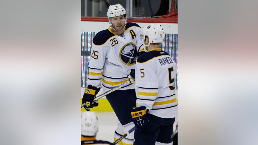 Buffalo Sabres' Thomas Vanek (26) celebrates his goal with Sabres' Chad Ruhwedel (5) in the first period of an NHL hockey game against the Pittsburgh Penguins in Pittsburgh Tuesday, April 23, 2013. (AP Photo/Gene Puskar)