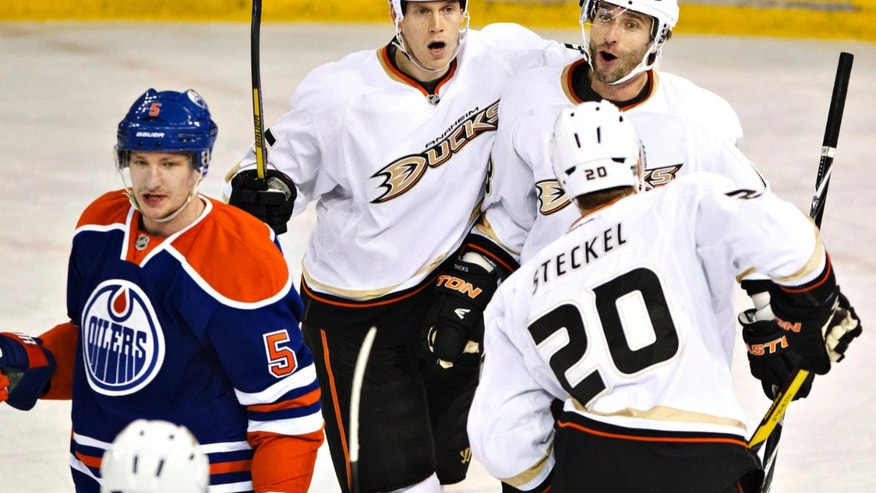 Anaheim Ducks Bryan Allen (55), Radek Dvorak (18) and David Steckel (20) celebrate a goal as Edmonton Oilers Ladislav Smid (5) skates by during first period NHL hockey action in Edmonton, on Monday April 22, 2013. (AP Photo/The Canadian Press, Jason Franson)