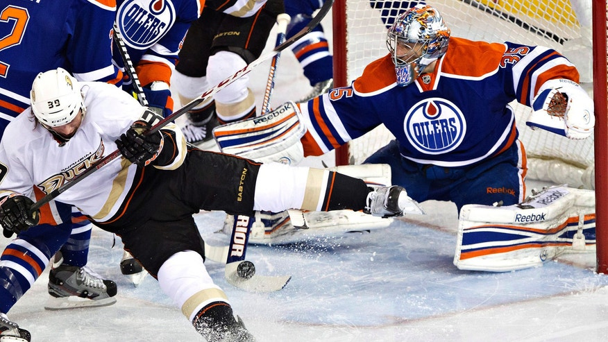 Anaheim Ducks' Matt Beleskey (39) is stopped by Edmonton Oilers goalie Nikolai Khabibulin (35) during the first period of their NHL hockey game in Edmonton, Alberta, Monday, April 22, 2013. (AP Photo/The Canadian Press, Jason Franson)
