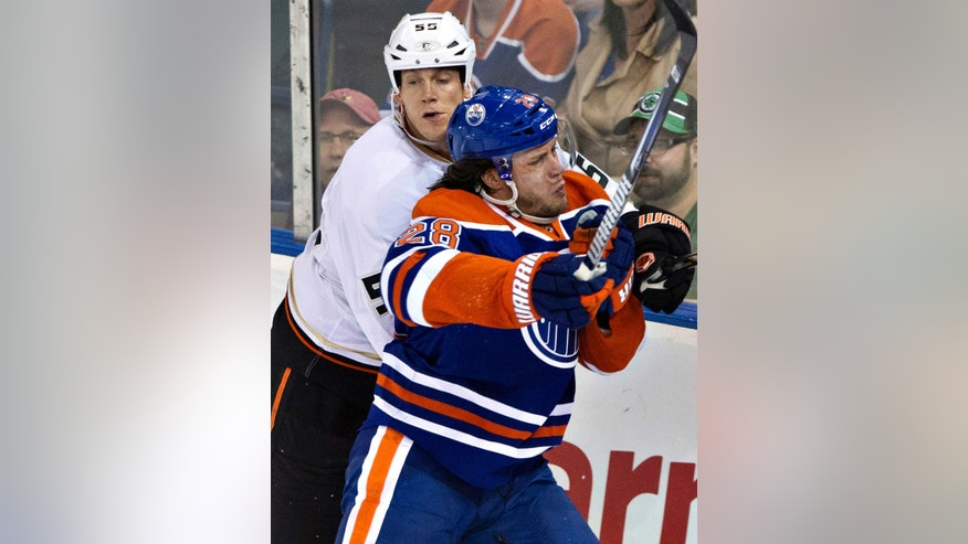 Anaheim Ducks Bryan Allen (55) is checked by Edmonton Oilers Ryan Jones (28) during second period NHL hockey action in Edmonton, Alberta, on Monday April 22, 2013. (AP Photo/The Canadian Press, Jason Franson)
