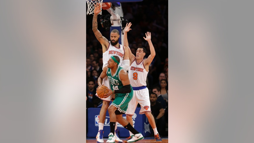 New York Knicks center Tyson Chandler (6) and guard Pablo Prigioni (9) defend agaionst Boston Celtics forward Paul Pierce (34) in the first half of Game 2 of their first-round NBA basketball playoff series in New York, Tuesday, April 23, 2013.  (AP Photo/Kathy Willens)