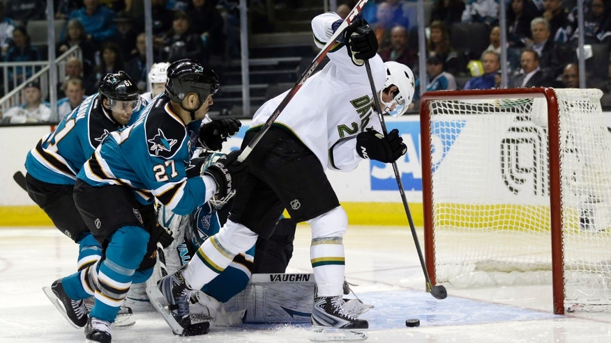 Dallas Stars left wing Loui Eriksson, of Sweden, center, scores against the San Jose Sharks during the second period of an NHL hockey game in San Jose, Calif., Tuesday, April 23, 2013. (AP Photo/Marcio Jose Sanchez)