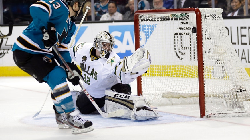 San Jose Sharks left wing Raffi Torres, left, scores past Dallas Stars goalie Kari Lehtonen, of Finland, during the first period of an NHL hockey game in San Jose, Calif., Tuesday, April 23, 2013. (AP Photo/Marcio Jose Sanchez)
