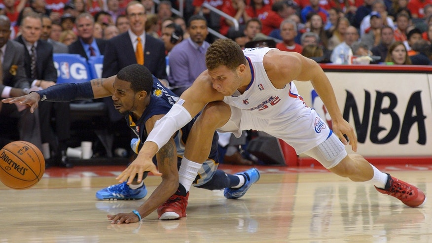 Memphis Grizzlies guard Mike Conley left, and Los Angeles Clippers forward Blake Griffin go after a loose ball during the second half of Game 2 of a first-round NBA basketball playoff series, Monday, April 22, 2013, in Los Angeles.  (AP Photo/Mark J. Terrill)