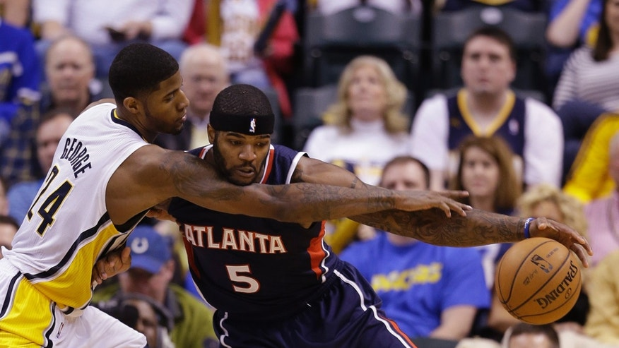 Atlanta Hawks' Josh Smith (5) is defended by Indiana Pacers' Paul George during the second half of Game 1 in the first round of the NBA basketball playoffs Sunday, April 21, 2013, in Indianapolis. Indiana defeated Atlanta 107-90. (AP Photo/Darron Cummings)