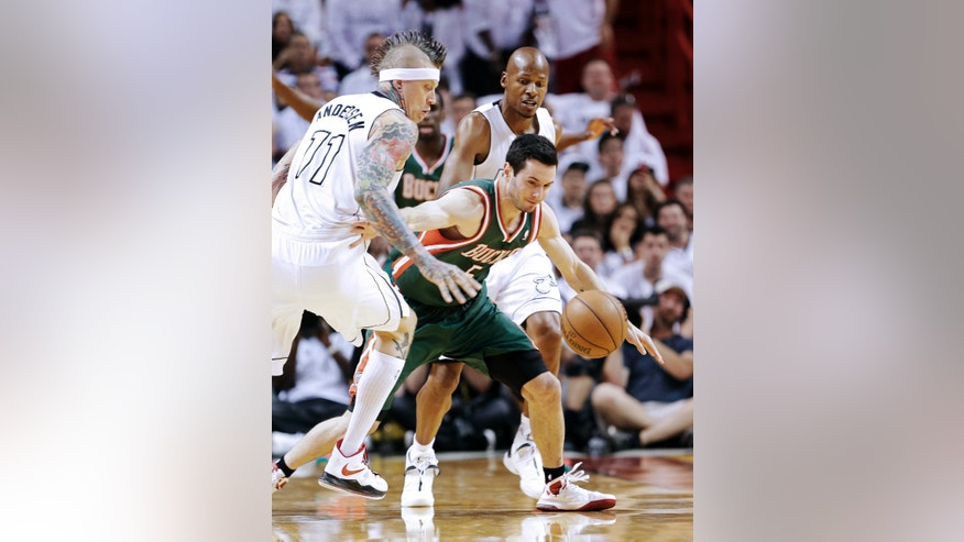 Miami Heat forward Chris Andersen (11) and guard Ray Allen, rear, battle for a loose ball with Milwaukee Bucks guard J.J. Redick during the first half of Game 2 in their first-round NBA basketball playoff series, Tuesday, April 23, 2013 in Miami. The Heat defeated the Bucks 98-86. (AP Photo/Wilfredo Lee)