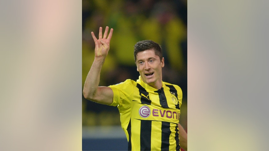 Dortmund's Robert Lewandowski celebrates after scoring his side's fourth goal during the Champions League semifinal first leg soccer match between Borussia Dortmund and Real Madrid in Dortmund, western Germany, Wednesday, April 24, 2013. (AP Photo/dpa, Federico Gambarini)