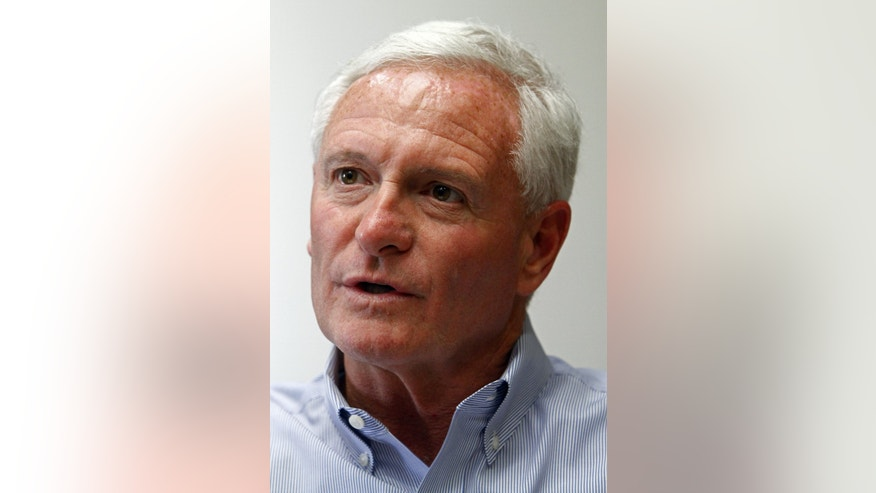 FILE - In this April 19, 2013 file photo, Jimmy Haslam, CEO of Pilot Flying J, speaks during a press conference at the company headquarters in Knoxville, Tenn. Haslam, who also owns the NFL's Cleveland Browns, is the brother of Tennessee Gov. Bill Haslam. The prominent Haslam family is trying to control the damage following a federal investigation into the family business that could threaten to unravel decades of growing wealth and influence that spans business, sports and politics in the state and beyond.An affidavit released after an April 15 raid of the company's headquarters by FBI and Internal Revenue Service agents alleges that sales employees withheld rebates owed to customers so they could boost profits and pad their commissions. o charges have been filed in the case as the investigation continues.  (AP Photo/Wade Payne, File)