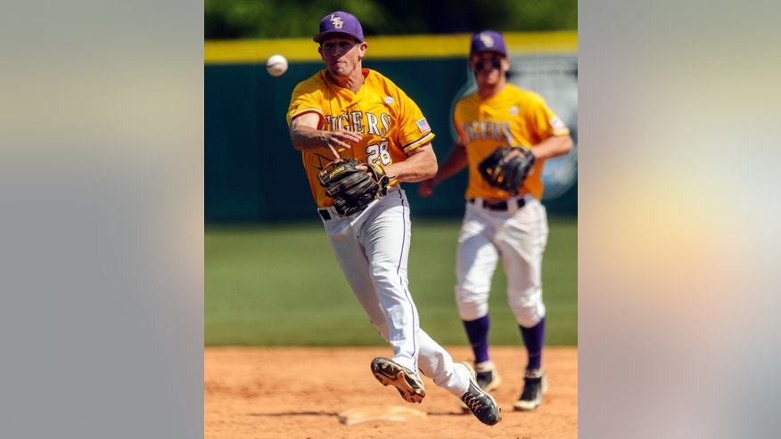 LSU second baseman Casey Yocom (28) gets the Alabama runner at first during their NCAA college baseball game, Sunday, April 21, 2013, in Tuscaloosa, Ala. Alabama won 4-3 in the 10th inning. (AP Photo/Alabama Media Group, Vasha Hunt)  MAGS OUT