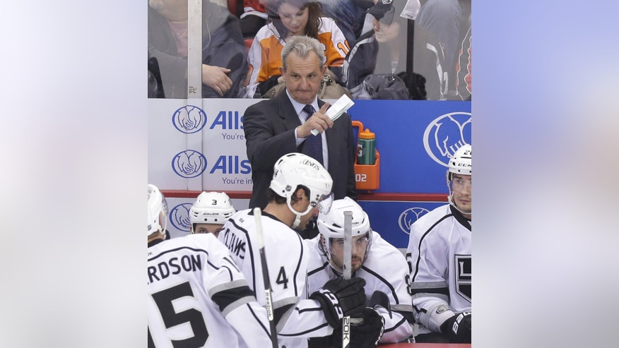 Los Angeles Kings head coach Darryl Sutter talks to his team during a timeout in the second period of an NHL hockey game against the Detroit Red Wings in Detroit, Wednesday, April 24, 2013. (AP Photo/Carlos Osorio)