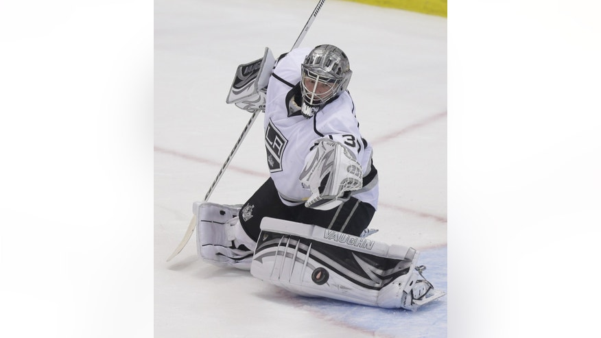 Los Angeles Kings goalie Jonathan Quick (32) deflects a shot during the second period of an NHL hockey game against the Detroit Red Wings in Detroit, Wednesday, April 24, 2013. (AP Photo/Carlos Osorio)