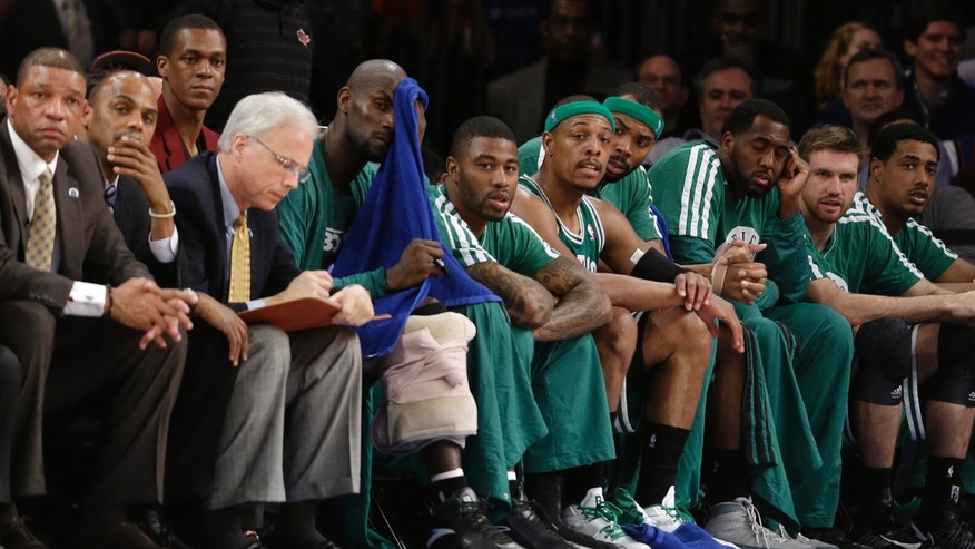 Boston Celtics head coach Doc Rivers, far left, injured guard Rajon Rondo, third from left, center Kevin Garnett, fifth from left, guard Terrence Williams, sixth from left, forward Paul Pierce, fifth from right, and forward Chris Wilcox, fourth from right, watch the fourth quarter of their first-round NBA basketball playoff series against the New York Knicks in New York, Tuesday, April 23, 2013. The Knicks won 87-71. (AP Photo/Kathy Willens)
