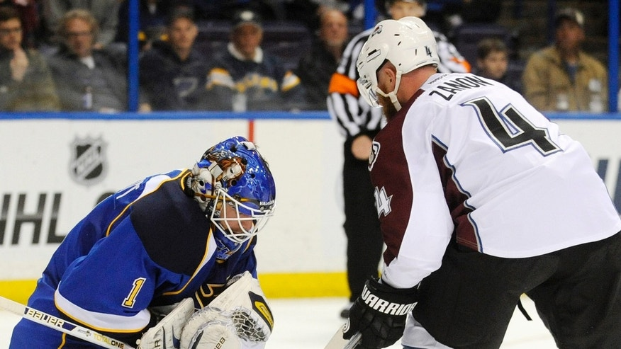 St. Louis Blues goalie Brian Elliot (1) blocks a shot by Colorado Avalanche's Greg Zanon (4) in the first period of an NHL hockey game Tuesday, April 23, 2013, in St. Louis. (AP Photo/Bill Boyce)