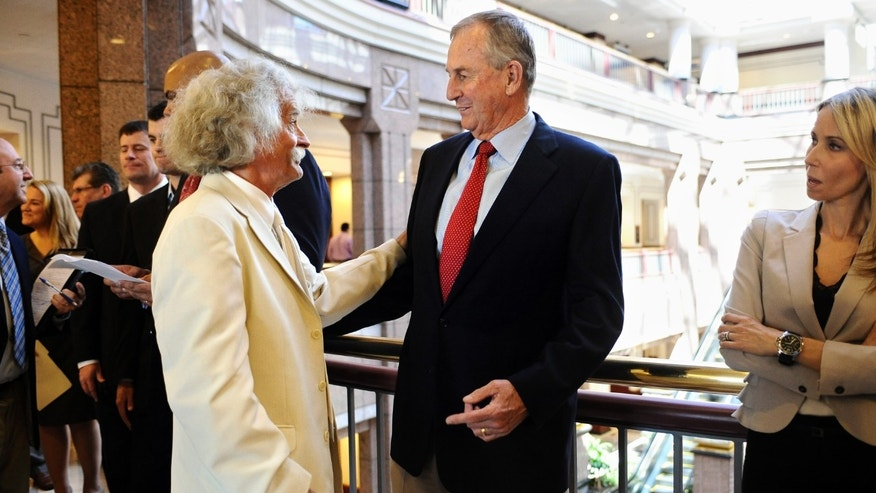 Former Connecticut men's head basketball coach Jim Calhoun, right, talks with William Clement during an induction ceremony into the state's Hall of Fame at the Legislative Office Building in Hartford, Conn., Wednesday, April 24, 2013. Calhoun was inducted on Wednesday along with Connecticut women's head basketball coach Geno Auriemma, Roger Sherman, a founding father who helped draft the Declaration of Independence, and toy maker A.C. Gilbert, known for creating the erector set. (AP Photo/Jessica Hill)