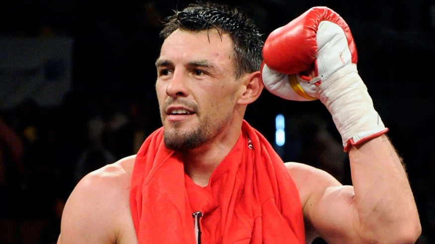 LAS VEGAS - JULY 31:  Robert Guerrero celebrates his unanimous-decision victory over Joel Casamayor in their junior welterweight fight at the Mandalay Bay Events Center July 31, 2010 in Las Vegas, Nevada.  (Photo by Ethan Miller/Getty Images) *** Local Caption *** Robert Guerrero