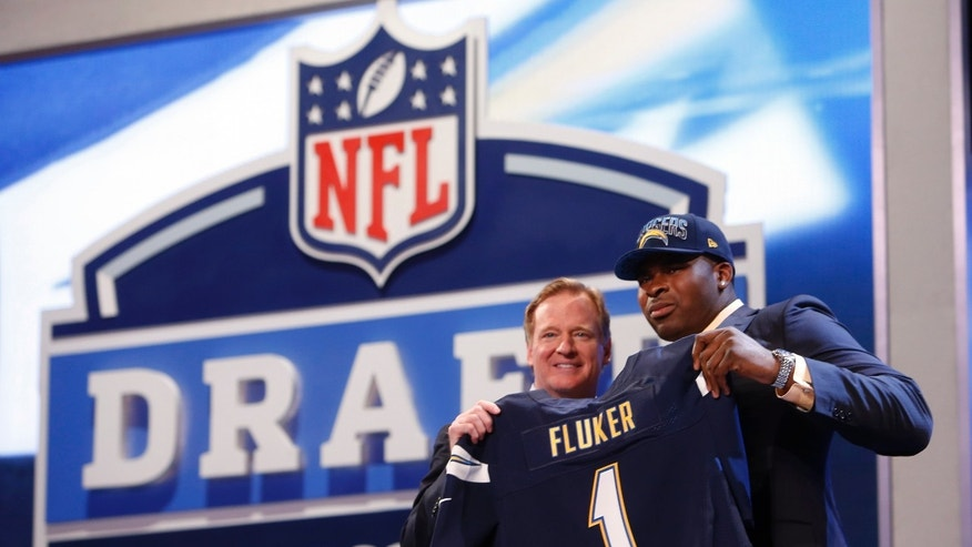 Tackle D.J. Fluker from Alabama stands with NFL commissioner Roger Goodell after being selected 11th overall by the San Diego Chargers in the first round of the NFL football draft, Thursday, April 25, 2013 at Radio City Music Hall in New York. (AP Photo/Jason DeCrow)