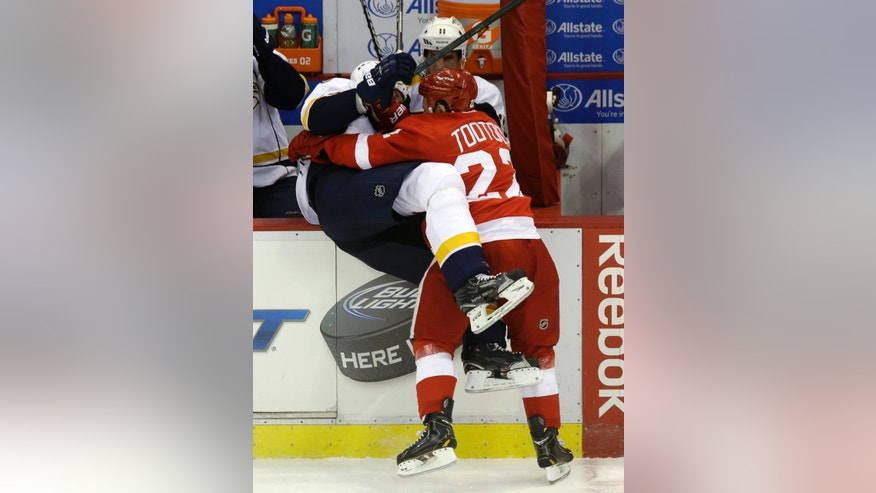 Detroit Red Wings right wing Jordin Tootoo (22) checks Nashville Predators defenseman Hal Gill into the bench area during the third period of an NHL hockey game in Detroit, Thursday, April 25, 2013. (AP Photo/Carlos Osorio)