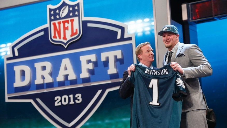 Lane Johnson, from Oklahoma, stands with NFL Commissioner Roger Goodell after being selected fourth overall by the Philadelphia Eagles in the first round of the NFL football draft, Thursday, April 25, 2013, at Radio City Music Hall in New York. (AP Photo/Jason DeCrow)