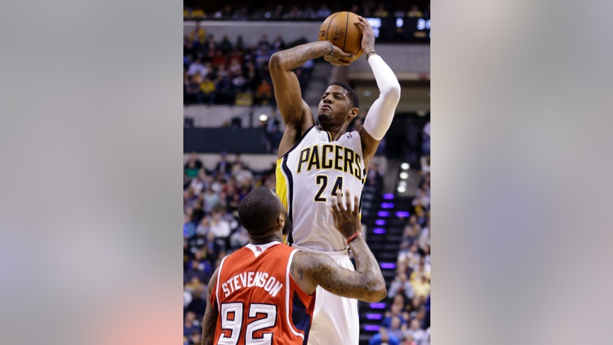 Indiana Pacers forward Paul George (24) shoots over Atlanta Hawks forward DeShawn Stevenson in the second half of Game 2 of a first-round NBA basketball playoff series in Indianapolis, Wednesday, April 24, 2013. The Pacers won 113-98. (AP Photo/Michael Conroy)