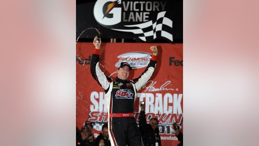 Kyle Busch celebrates winning the Denny Hamlin's Charity Race at Richmond International Raceway in Richmond, Va., Thursday April 25, 2013. (AP Photo/Steve Helber)
