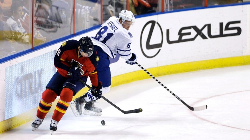 Florida Panthers' Scottie Upshall (19) steals the puck from Toronto Maple Leafs' Phil Kessel (81) during the first period of a NHL hockey game in Sunrise, Fla., Thursday, April 25, 2013. (AP Photo/J Pat Carter)