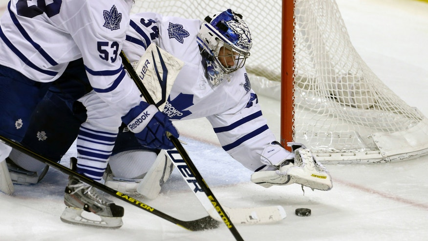 Toronto Maple Leafs goalie James Reimer stops a shot on goal by the Florida Panthers during the second period of a NHL hockey game in Sunrise, Fla., Thursday, April 25, 2013. (AP Photo/J Pat Carter)