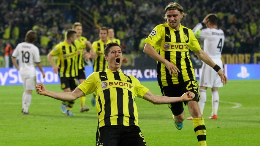 Dortmund's Robert Lewandowski, from Poland, celebrates after scoring his third goal during the Champions League semifinal first leg soccer match between Borussia Dortmund and Real Madrid in Dortmund, Germany, Wednesday, April 24 2013. (AP Photo/Frank Augstein)