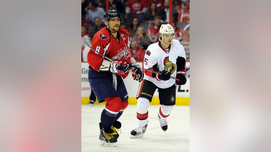 Ottawa Senators defenseman Erik Karlsson, right, of Sweden, skates next to Washington Capitals left wing Alex Ovechkin (8), of Russia, during the first period of an NHL hockey game, Thursday, April 25, 2013, in Washington. (AP Photo/Nick Wass)