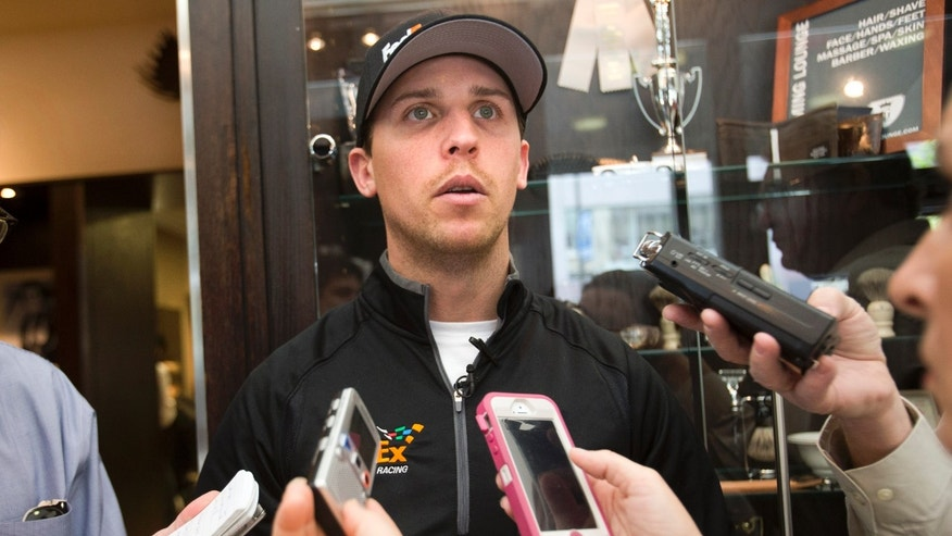 NASCAR Sprint Cup series driver Denny Hamlin of Richmond, Va. meets with reporters at The Grooming Lounge in Washington Wednesday, April 24, 2013, during an event with FedEx and the Red Cross to help small businesses prepare for disasters. Hamlin suffered a compound fracture in his back in a crash on March 24th. (AP Photo/Jacquelyn Martin)