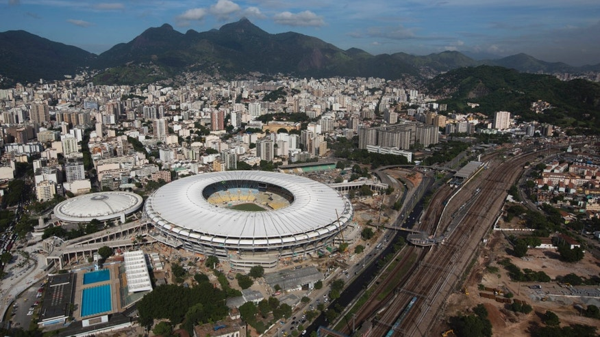 FILE - In this April 11, 2013 file photo, an aerial view shows the new rooftop of the Maracana Stadium, which is undergoing renovations in preparation for the 2013 Confederations Cup and 2014 World Cup, in Rio de Janeiro, Brazil. After almost three years of renovations, the Maracana Stadium is finally set to reopen in Brazil.  The inauguration on Saturday, April 27, 2013 comes after a series of delays and amid widespread criticism related to overspending and the venue's privatization.  (AP Photo/Felipe Dana, File)