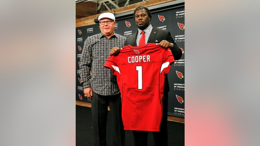 Arizona Cardinals head coach Bruce Arians, left, stands with first-round draft pick Jonathan Cooper after Cooper was introduced on Friday, April 26, 2013, at the Cardinals' training facility in Tempe, Ariz. Cooper was selected seventh overall in the NFL football draft. (AP Photo/Matt York)