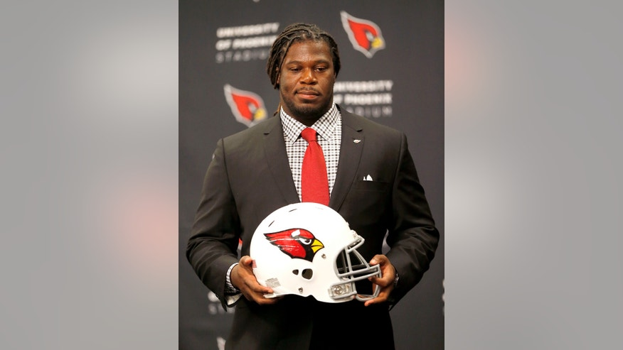Arizona Cardinals first-round draft pick Jonathan Cooper is introduced on Friday, April 26, 2013, at the Cardinals' training facility in Tempe, Ariz. Cooper was selected seventh overall in the NFL football draft. (AP Photo/Matt York)