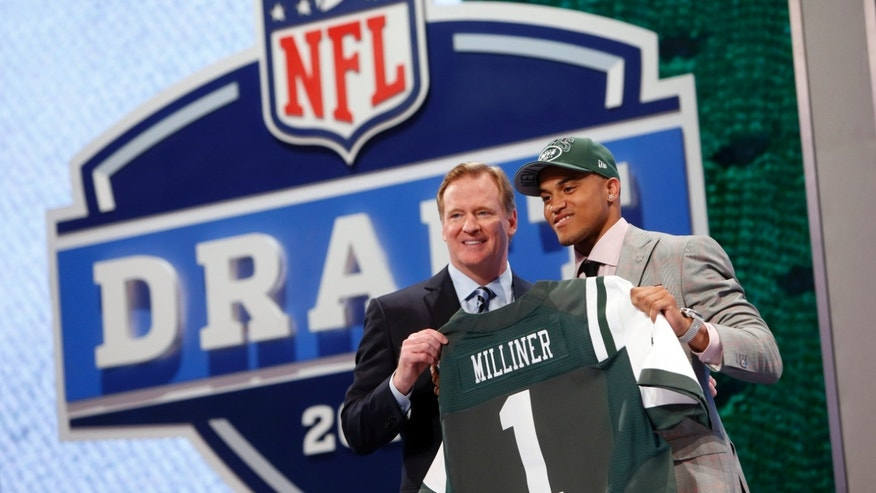 Dee Milliner, from Alabama, stands with NFL Commissioner Roger Goodell after being selected ninth overall by the New York Jets in the first round of the NFL football draft, Thursday, April 25, 2013, at Radio City Music Hall in New York. (AP Photo/Jason DeCrow)