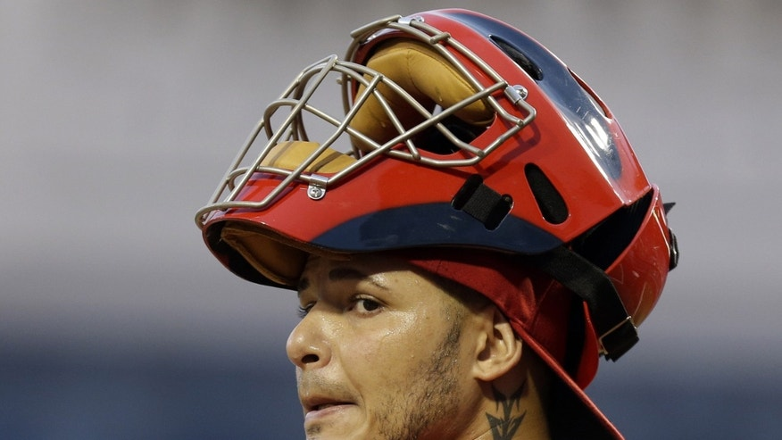 ADVANCE FOR WEEKEND EDITIONS, APRIL 27-28 - FILE -  In this photo taken April 16, 2013, St. Louis Cardinals catcher Yadier Molina takes his place behind the plate during a baseball game against the Pittsburgh Pirates. Fifteen years ago, shortstops such as Derek Jeter, Alex Rodriguez and Nomar Garciaparra changed the perception of their position from slick fielders with little pop to middle-of-lineup run producers. Now, it's do-everything catchers like Molina,  showing remarkable versatility from the crouch and the batter's box. (AP Photo/Gene J. Puskar, File)