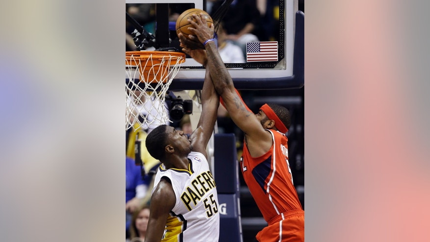 Indiana Pacers center Roy Hibbert (55) blocks the dunk of Atlanta Hawks forward Josh Smith in the second half of Game 2 of a first-round NBA basketball playoff series in Indianapolis, Wednesday, April 24, 2013. The Pacers won 113-98. (AP Photo/Michael Conroy)