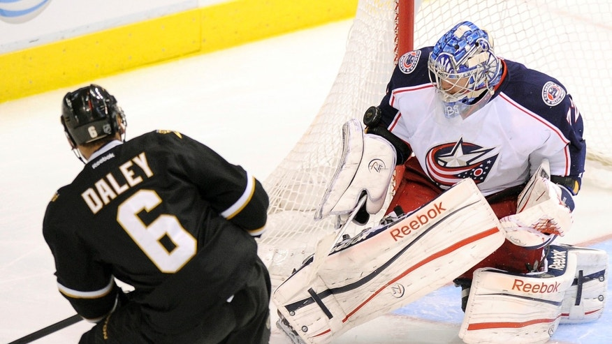 Columbus Blue Jackets goalie Sergei Bobrovsky (72) stops a shot by Dallas Stars defenseman Trevor Daley (6) during the third period of an NHL hockey game, Thursday, April 25, 2013, in Dallas. (AP Photo/Matt Strasen)