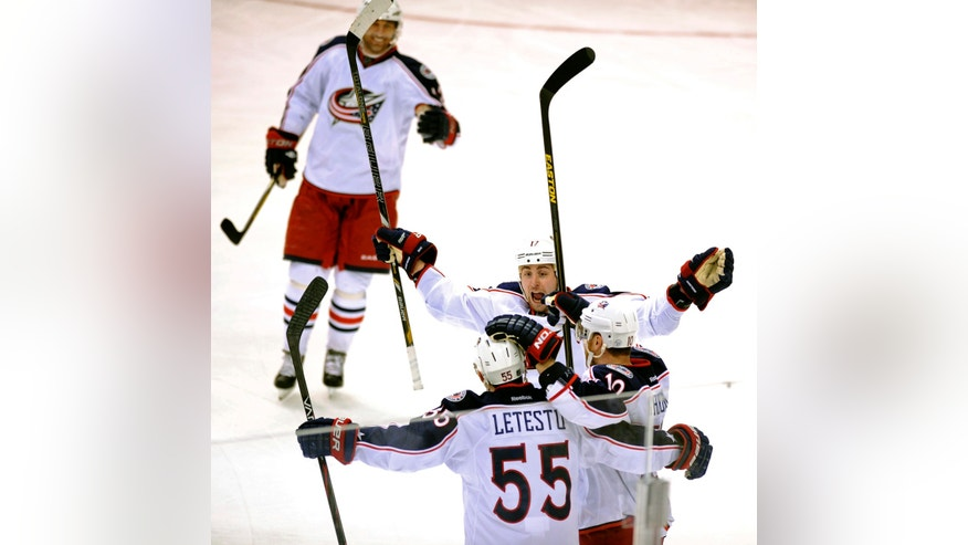Columbus Blue Jackets center Mark Letestu (55) celebrates his goal with teammates including right wing Marian Gaborik (10) and center Brandon Dubinsky (17) during the second period of an NHL hockey game against the Dallas Stars on Thursday, April 25, 2013, in Dallas. (AP Photo/Matt Strasen)