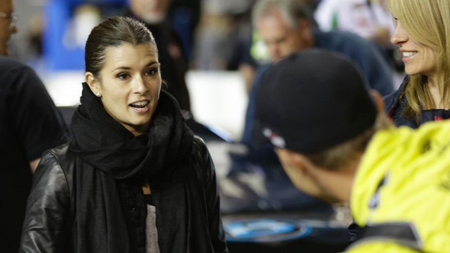 Danica Patrick, left, talks with Matt Kenseth before Denny Hamlin's charity race at Richmond International Raceway in Richmond, Va., Thursday, April 25, 2013. (AP Photo/Steve Helber)