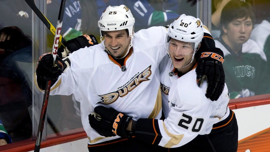 Anaheim Ducks' Brad Staubitz, left, and David Steckel celebrate Staubitz's goal against the Vancouver Canucks during the second period of an NHL hockey game in Vancouver, British Columbia, on Thursday, April 25, 2013. (AP Photo/The Canadian Press, Darryl Dyck)