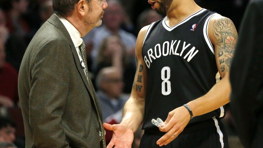 Brooklyn Nets point guard Deron Williams, right, talks to interim head coach P.J. Carlesimo during the second half of Game 3 of their first-round NBA basketball playoff series against the Chicago Bulls, Thursday, April 25, 2013, in Chicago. The Bulls won 79-76. (AP Photo/Charles Rex Arbogast)