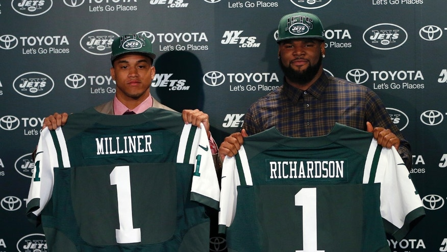 New York Jets' first round draft picks Dee Milliner, left, a cornerback from Alabama, and Sheldon Richardson, a defensive tackle from Missouri, holds up jerseys as they are introduced during an NFL football news conference at the team's practice facility in Florham Park, N.J., Friday, April 26, 2013. Milliner was selected ninth overall, while Richardson was selected 13th overall in Thurday's NFL draft. (AP Photo/Rich Schultz)