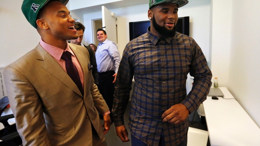 New York Jets' first round draft picks Dee Milliner, left, a cornerback from Alabama, and Sheldon Richardson, a defensive tackle from Missouri, smile after an NFL football news conference at the team's practice facility in Florham Park, N.J., Friday, April 26, 2013. Milliner was selected ninth overall, while Richardson was selected 13th overall in Thurday's NFL draft. (AP Photo/Rich Schultz)