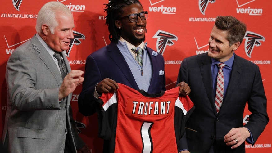 Atlanta Falcons first-round draft pick Desmond Trufant, center, and general manger Thomas Dimitroff laugh as head coach Mike Smith, left,  jokes with reporters during an NFL news conference at the team's headquarters Friday, April 26, 2013, in Flowery Branch, Ga. Trufant, a cornerback from Washington, was selected 22nd overall in Thursday's NFL draft. (AP Photo/John Bazemore)