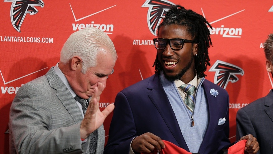 Atlanta Falcons first-round draft pick Desmond Trufant, right, laughs as head coach Mike Smith jokes with reporters during an NFL news conference at the team's headquarters Friday, April 26, 2013, in Flowery Branch, Ga. Trufant, a cornerback from Washington, was selected 22nd overall in Thursday's NFL draft. (AP Photo/John Bazemore)