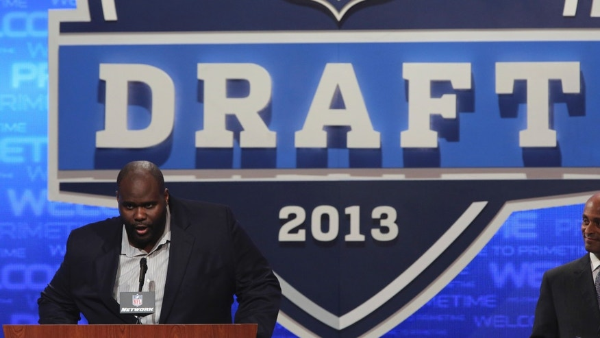 Former Indianapolis Colts offensive tackle Tarik Glenn announces an NFL football draft pick during the third round on Friday, April 26, 2013, at Radio City Music Hall in New York.  (AP Photo/Mary Altaffer)