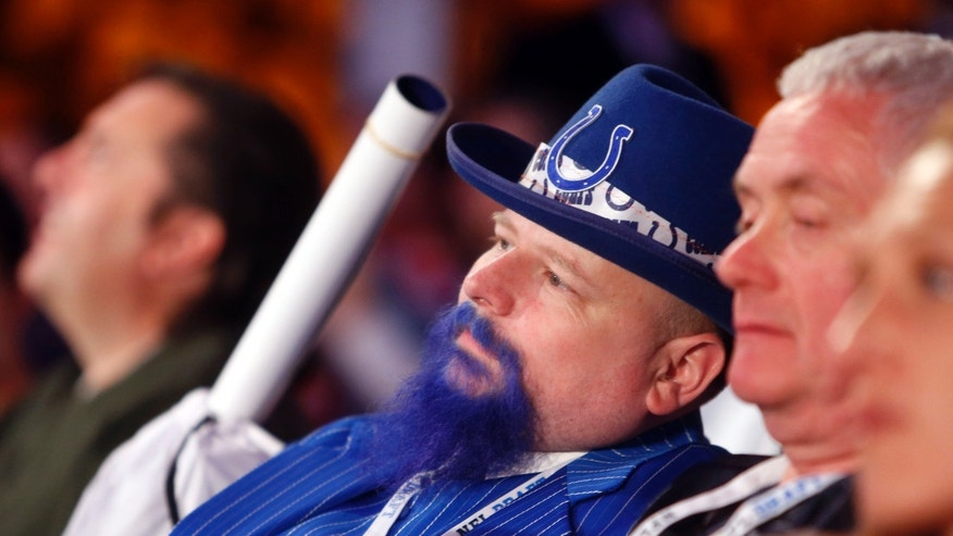 Indianapolis Colts fan Matt Hartwell, of Franklin, Ind., watches from the audience during the second round of the NFL football draft on Friday, April 26, 2013, at Radio City Music Hall in New York. (AP Photo/Jason DeCrow)
