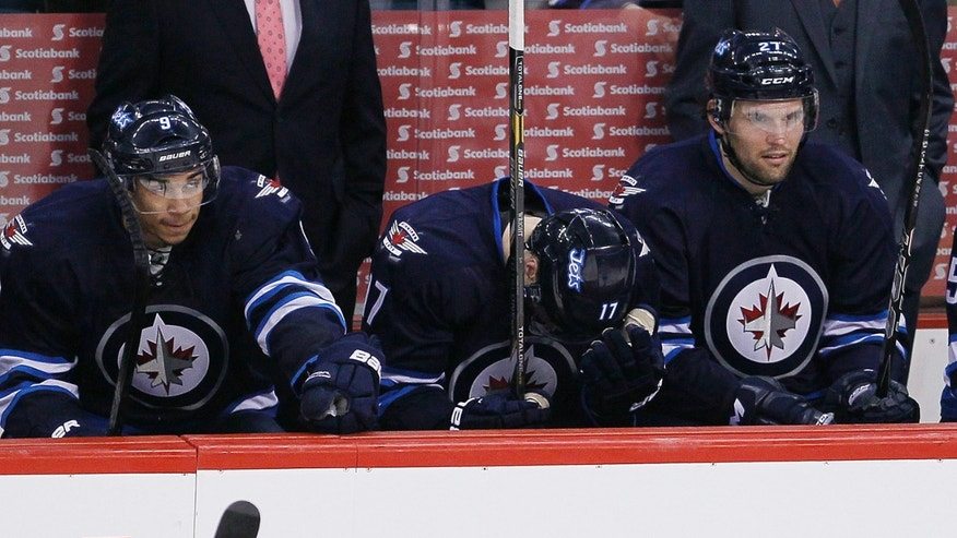 Winnipeg Jets' James Wright (17), Evander Kane (9) and Eric Tangradi (27) lose to the Montreal Canadiens during third-period NHL hockey game action in Winnipeg, Manitoba, Thursday, April 25, 2013. (AP Photo/The Canadian Press, John Woods)