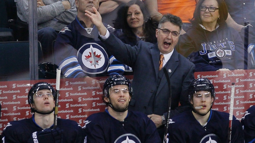 Winnipeg Jets' Winnipeg Jets head coach Claude Noel disputes a call during third-period NHL hockey game action against the Montreal Canadiens in Winnipeg, Manitoba, Thursday, April 25, 2013. (AP Photo/The Canadian Press, John Woods)